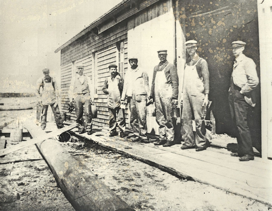 Crosby's shop workers ready for a day's labor with H. Manley Crosby on the far right dressed for business. You could always find this designer and builder of the Wianno Senior in a suit.