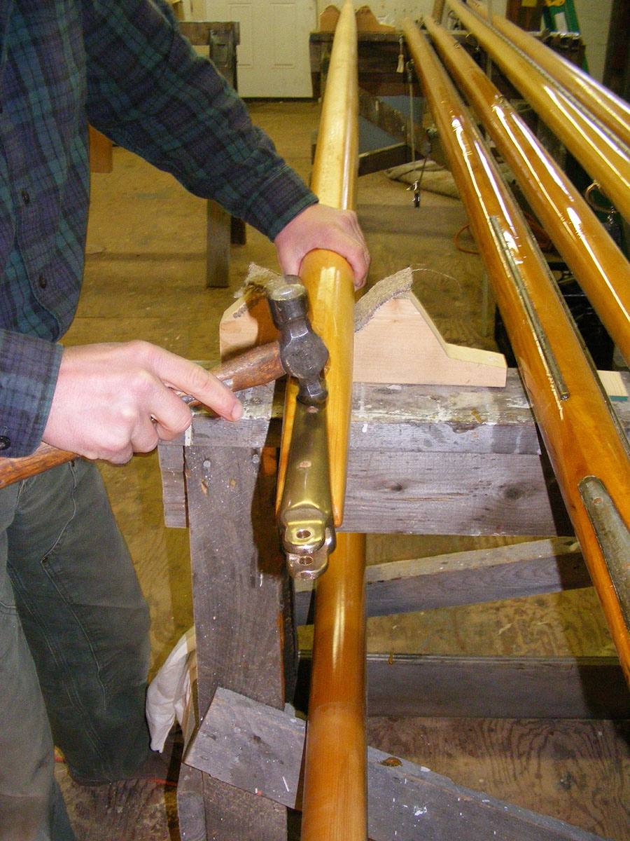 Ted Crosby, (his grandfather and Ned's great grandfather were brothers), installing gaff hardware for a Wianno Senior.