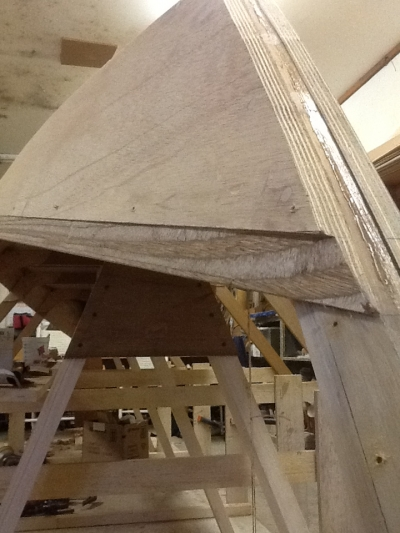 """Dory on mold setup, showing ¾"""" marine plywood garboard planks, in place with rebate cut. (Bottom would later be sheathed with Dynel and epoxy.)"""