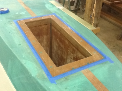 Box fastened and bedded down in boat. (Note – all interior surfaces of the motorwell were seated with a layer of 6oz glass and epoxy.)