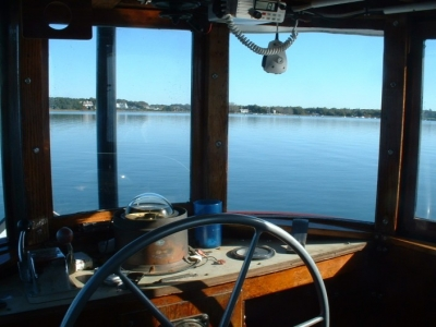 """View from the helm of the shop workboat """"Admiral"""" on a quiet, still morning. E.M.Crosby Boatworks pumps customer's boats after storms and prepares the boats for weekends."""