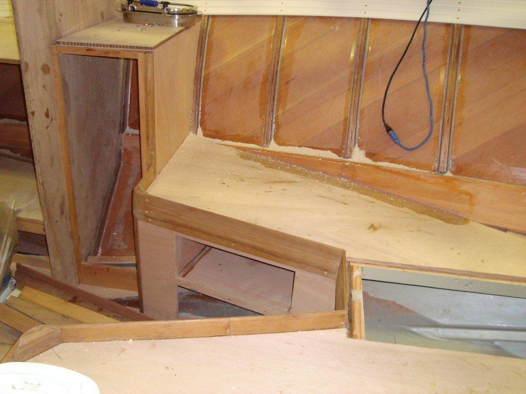 "Her ""vee"" berth is coming together nicely… visible is her inner layer of Spanish cedar."