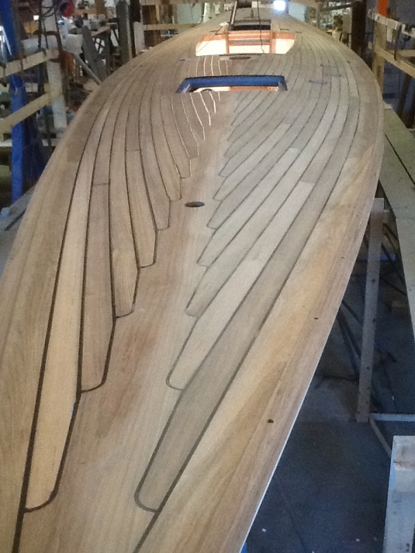 Teak over plywood deck ... paying deck seams ... no fasteners used.