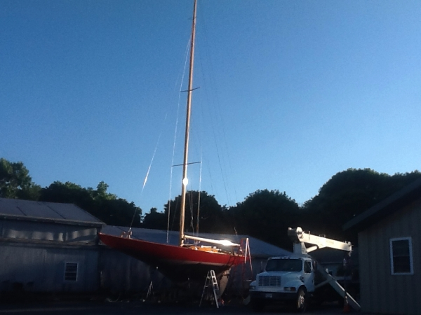Stepping her mast for the first time and assembling her rig.